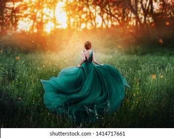 girl queen red hair runs dark mysterious forest, lady long elegant royal emerald dress flying train, amazing spring tree grass fiery sunset art photo bare open back no face turned away clothes costume