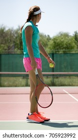 girl with a racket playing tennis on the court