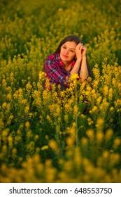 Girl in rape, yellow flowers, yellow sunlight