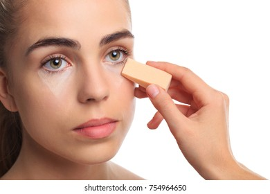 A girl is rattled under the eye contours on a white isolated background