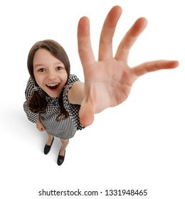 Girl reaching out her hand. Kid is amazed by something and trying to touch it. Funny fisheye shot with big hand.