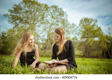 Girl reading the bible in nature