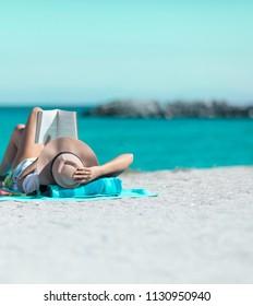 girl reading book in beach