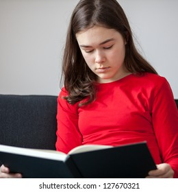 Girl reading book at home