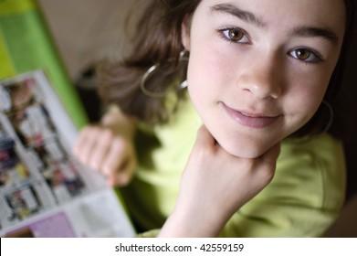 Girl reading magazine