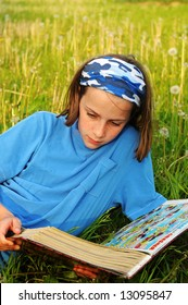 girl reading in a meadow