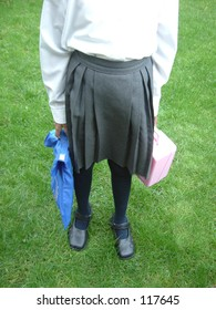 Girl is ready to go to school in uniform