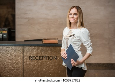 The girl at the reception desk. The girl is the administrator. Hostess