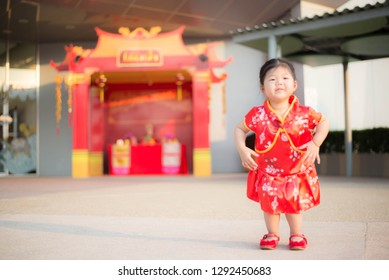 Girl in red Chinese dress.
