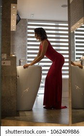girl in the red dress in the bathroom
