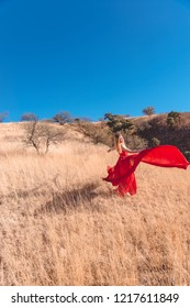 Girl in a red dress in fields Nogales, Sonora, Mexico