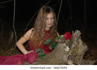Girl in a red dress with a rose