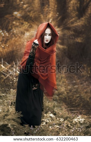 2abdb933c22 The girl with the red hair. A Ghost with a white face in a black dress -  Image