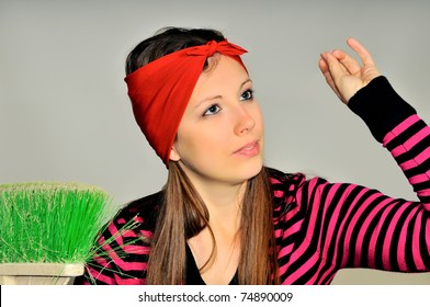 Girl with a red handkerchief on his head preparing to clean the apartment