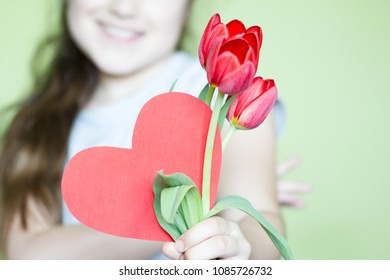 Girl with red heart and flowers celebration mothers day concept