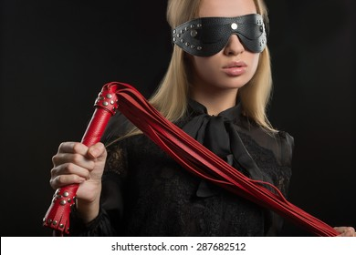 girl with red leather whip and mask BDSM