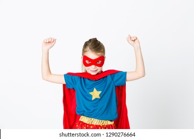 girl with red mask and supergirl outfit posing