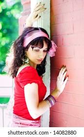 girl in red near church wall