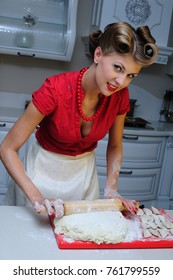 Girl in red on the kitchen