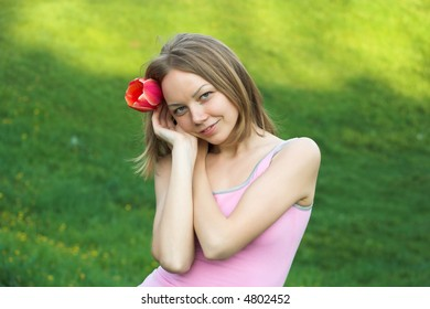 Girl with red tulip
