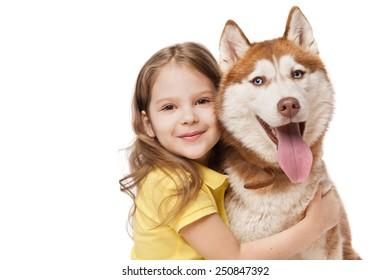 Girl with a redhead husky