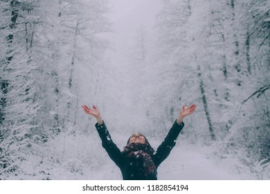 Girl rejoices in the snow