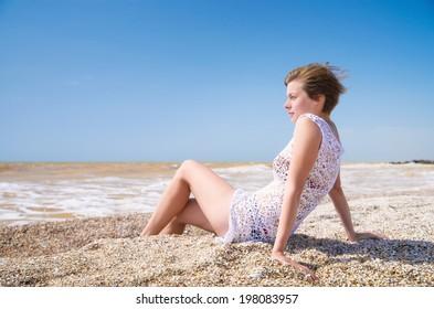 Girl relax on beach. Beach life concept