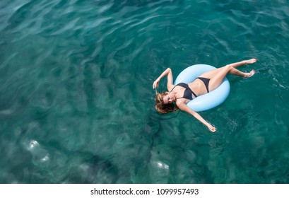 Girl relax on the sea. Beautiful girl as a concept and idea of relax time