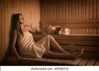 The girl relaxes in a sauna