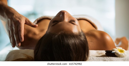 The girl relaxes in the spa and gets massage