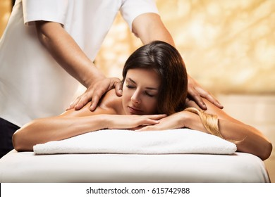 The girl relaxes in a spa salon and gets massage