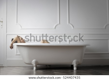 Girl relaxing in a bathtub