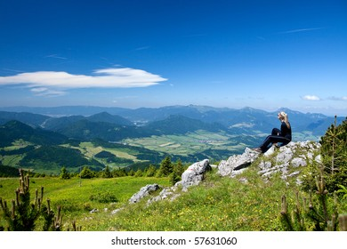Girl is relaxing during climbing to Velky Chocz Peak, Slovakia