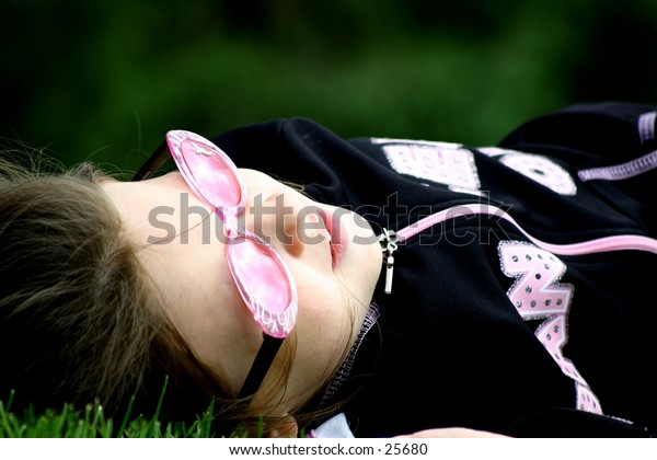 Girl relaxing in grass.