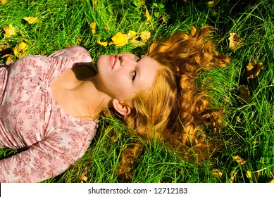 Girl is relaxing on the grass