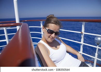 Girl relaxing on a yacht at sea, and fresh air