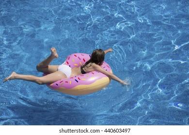 Girl Relaxing in the Pool
