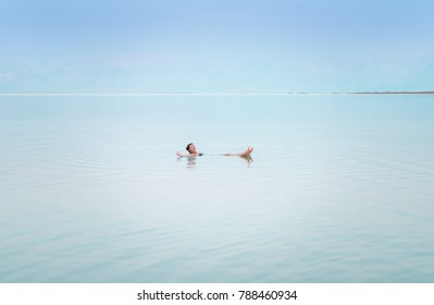 Girl relaxing in the water of Dead Sea.
