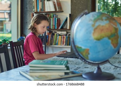 Girl remote studing online at home infront of the laptop