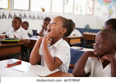 Girl responding during a lesson at an elementary school