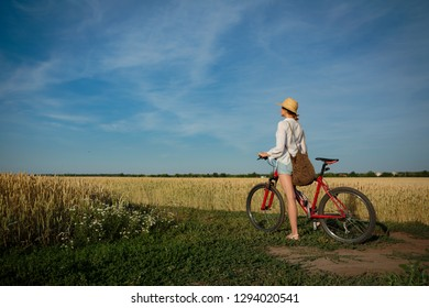 Girl rest countryside on weekend with bicycle, copy space
