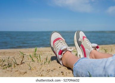 A girl is resting on the beach