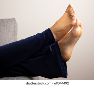 girl resting on sofa, extreme closeup of foots