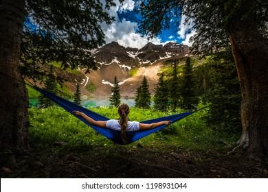 Girl rests on a Hammock near Lower Blue Lake Ridgway Colorado USA