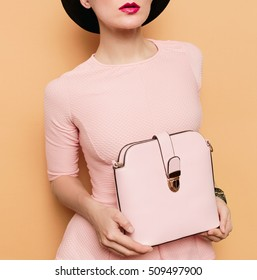 Girl in retro style. Accessories hat and bag. Vanilla style fashion
