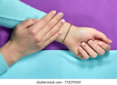 Girl with rhinestones on manicure, nails turquoise purple colour
