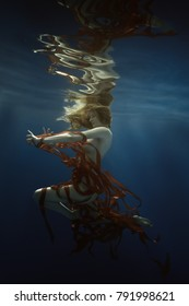 Girl with ribbons underwater