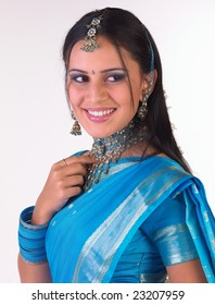 Girl with rich necklace in blue silk sari