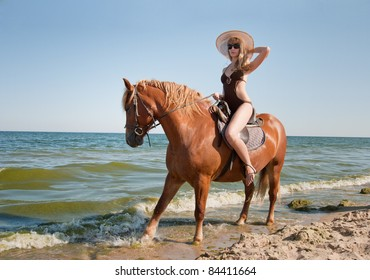 Girl rides on horse