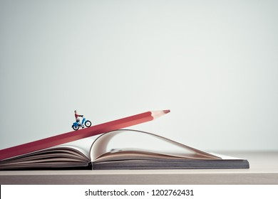Girl rides on a motorcycle over open diary book. Travel concept
